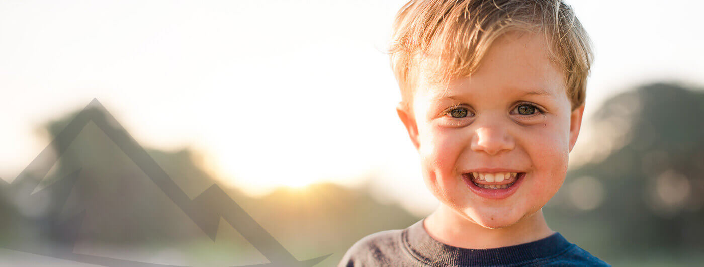 Smiling little boy outdoors