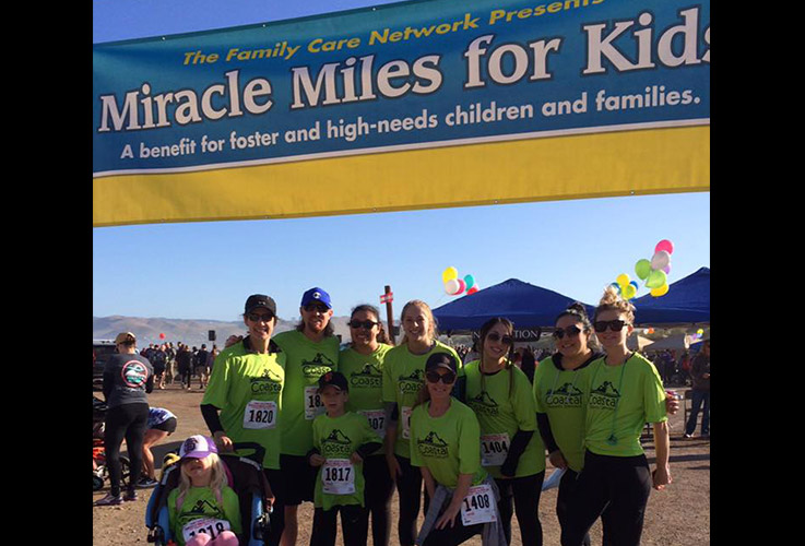 Team members at Miracle Miles for Kids event