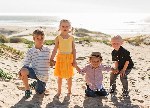 Four young children on beach