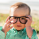 Smiling little boy with glasses