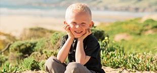 Smiling young boy on the beach