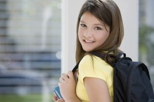Young girl with a backpack.