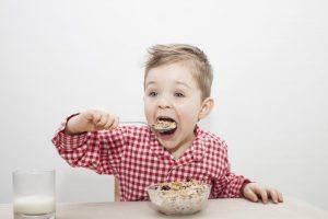 boy eating granola